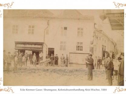 Historische Ansicht von 1884 auf die Kolonialwarenhandlung Alois Wuchse, Ecke Kremser Gasse/Brunngasse. (Grafik: G&L Werbe und Verlags GmbH)
