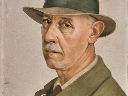 Ein Gemälde, auf dem das Selbstporträt des Gründungsobmannes des St. Pöltner Künstlerbundes Adolf Peschek, zu sehen ist.